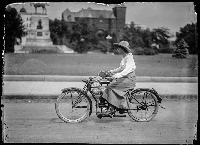 Woman on a motorcycle, 1917