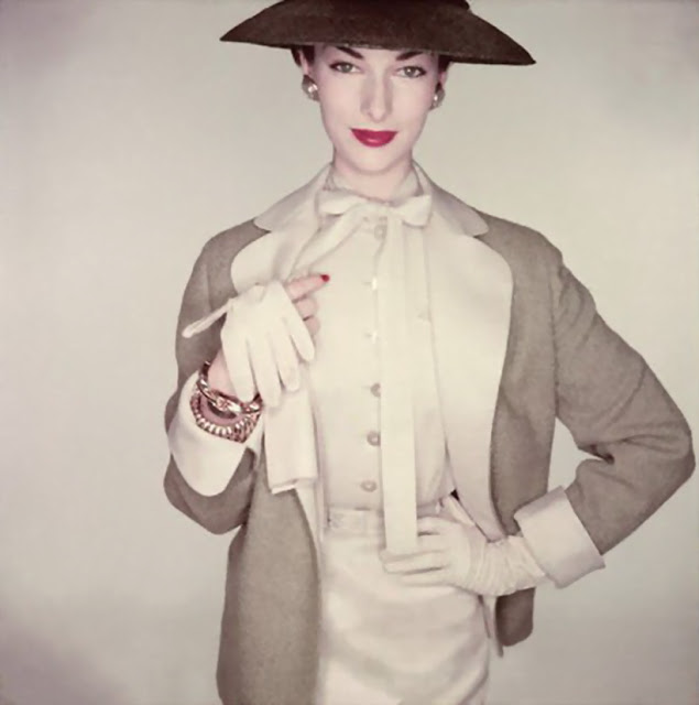 ca. 1953 --- Model wearing linen blouse and skirt with pigskin gloves by Superb. --- Image by ?Cond?Nast Archive/CORBIS