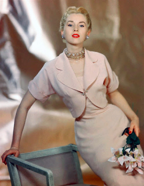 ca. 1949 --- Model wearing a pink town suit of spun rayon by Joyce Hubrite --- Image by © CondÈ Nast Archive/CORBIS